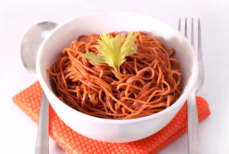 Delicious homemade fried noodle on the table photo