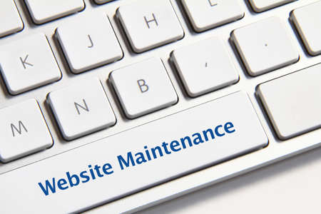 Website maintenance icon on white keyboard button photo