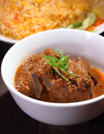 Nasi Briyani is a wholesome rice-based dish prepared with spices, rice, meat and vegetables  photo