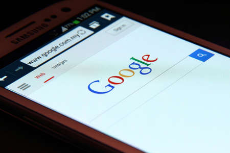 Johor, Malaysia - May 06, 2014: Google website on smartphone screen. Google Inc. is an American multinational corporation specializing in Internet-related services and products, May 06, 2014 in Johor, Malaysia.