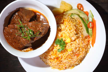 asian foods: Nasi Briyani is a wholesome rice-based dish prepared with spices, rice, meat and vegetables. Stock Photo