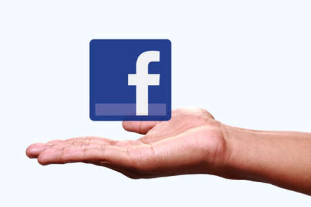 Johor, Malaysia - Jun 24, 2014  Hand showing Facebook icon, Facebook is a popular free social networking website in the world, Jun 24, 2014 in Johor, Malaysia