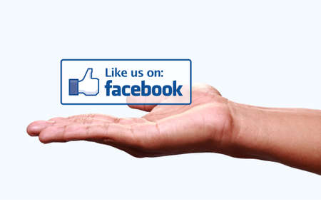 Johor, Malaysia - Jun 24, 2014: Hand showing like us on Facebook icon, Facebook is a popular free social networking website in the world, Jun 24, 2014 in Johor, Malaysia.