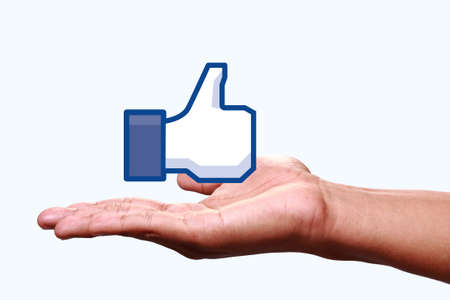 Johor, Malaysia - Jun 24, 2014: Hand showing a like icon. Like icon button is the voting system used to rate user comments on Facebook, Jun 24, 2014 in Johor, Malaysia.