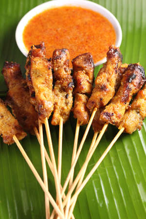 spicy chicken: Malaysian chicken satay with delicious peanut sauce one of famous local dishes. Stock Photo