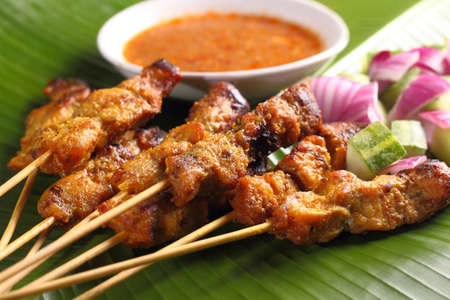 Malaysian chicken satay with delicious peanut sauce, one of famous local dishes.
