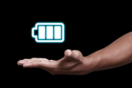 Hand showing a battery icon Archivio Fotografico