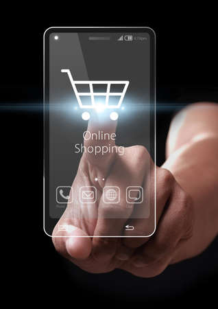 e commerce: Hand pressing online shopping on a virtual screen