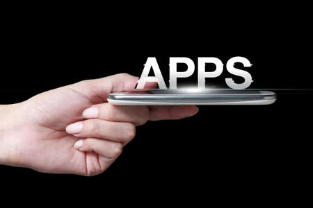 smartphone apps: Hand holding smartphone with apps icon Stock Photo