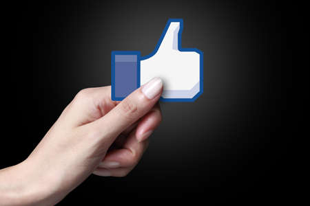 Johor, Malaysia - Sep 15, 2014: Hand showing a like icon. Like icon button is the voting system used to rate user comments on Facebook, Sep 15, 2014 in Johor, Malaysia.
