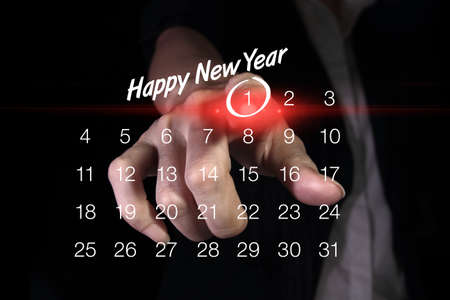 new years day: Hand pointing New Years Day Stock Photo