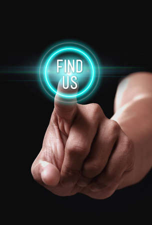 find us: Hand pressing find us icon on a virtual screen