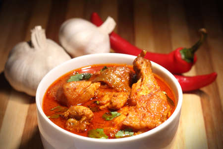 Chicken curry with onions and chili Stock Photo