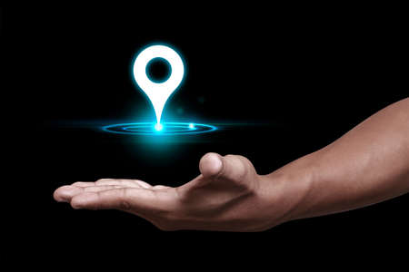 Hand showing GPS and Navigation pin