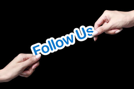 follow us: Hand giving follow us icon to another person Stock Photo
