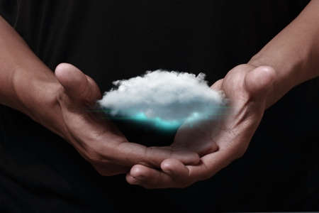 Cloud computing icon with hand