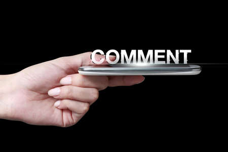 Hand holding smartphone with comment icon