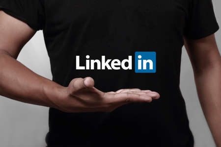 Johor, Malaysia - May 11, 2014: Hand showing Linkedin icon. Linkedin is a famous social networking website, May 11, 2014 in Johor, Malaysia.