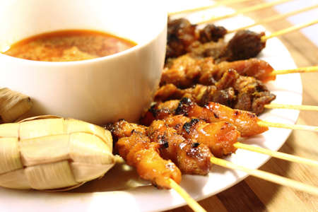 peanut sauce: Satay is a Malaysian-style kebab. It is served with a peanut sauce, and slivers of cucumbers and onions.