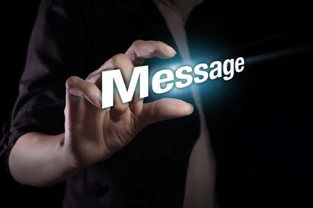 message text: Hand showing message text on the virtual screen Stock Photo