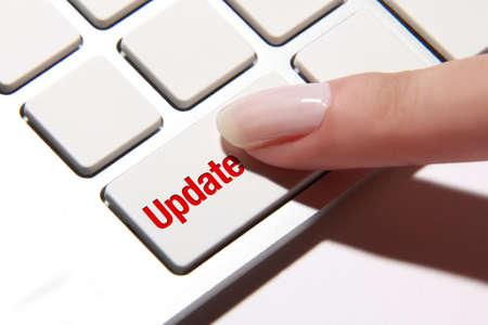 Hand press on update button Standard-Bild