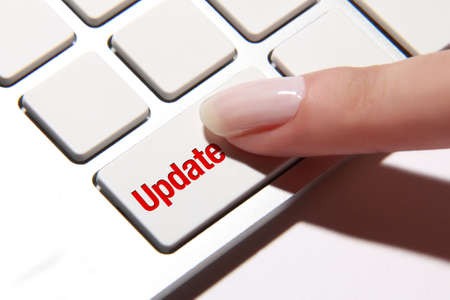 hand press: Hand press on update button Stock Photo