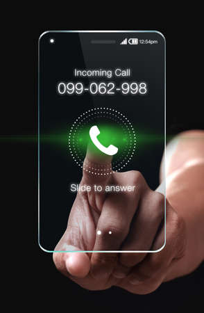 incoming: Hand pressing Incoming call icon on smartphone. A smartphone is a mobile phone with an advanced mobile operating system.