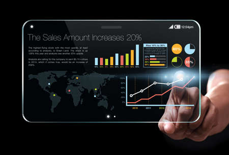 Hand showing a transparent tablet with colorful business information on screen, representing business growth. Chart is colorful and the background is black. Standard-Bild