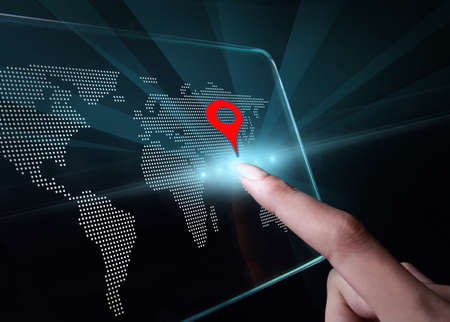 employing: Hand pointing a map on transparent 3D smartphone with black background. A 3D phone is a mobile phone that conveys depth perception to the viewer by employing stereoscopy or any other form of 3D depth techniques.