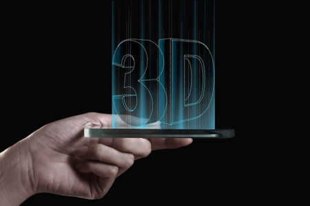 conveys: Hand holding transparent 3D smartphone. A 3D phone is a mobile phone that conveys depth perception to the viewer by employing stereoscopy or any other form of 3D depth techniques. Stock Photo