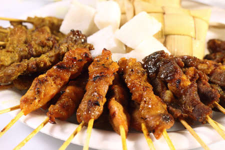 slivers: Satay is a Malaysian-style kebab. It is served with a peanut sauce, and slivers of cucumbers and onions.