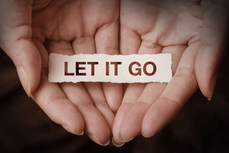 go: Let it go text on hand design concept Stock Photo