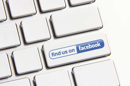 find us: Johor, Malaysia - Jun 14, 2014: Find us on Facebook icon on keyboard button, Facebook is a popular free social networking website in the world, Jun 14, 2014 in Johor, Malaysia.
