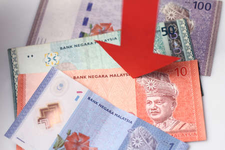 down arrow: Malaysian Ringgit with a red arrow to imply the fall or devaluation of Malaysian ringgit currencies.