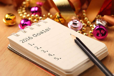 new year: New Years goals with colorful decorations. New Year's goals are resolutions or promises that people make for the New Year to make their upcoming year better in some way. Stock Photo