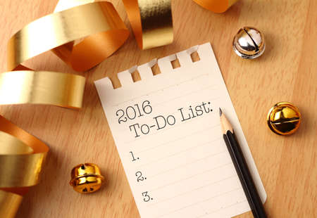 todo list: New Years to-do list with gold color decorations. New Year's goals are resolutions or promises that people make for the New Year to make their upcoming year better in some way.