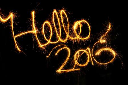 hello: Hello 2016 written with a sparkler on a black background Stock Photo