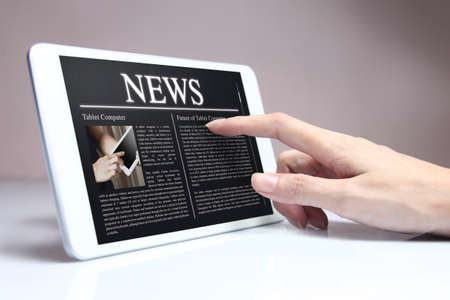 e books: Tablet with hot news on screen. Tablet & smartphone reading of newspapers continues to grow rapidly in the future.