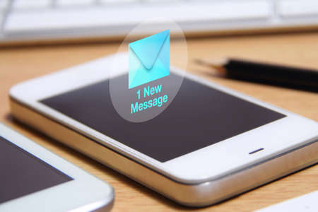 mobile sms: Smartphone and new message icon. A message is a short communication sent from one person to another or the central theme or idea of a communication.