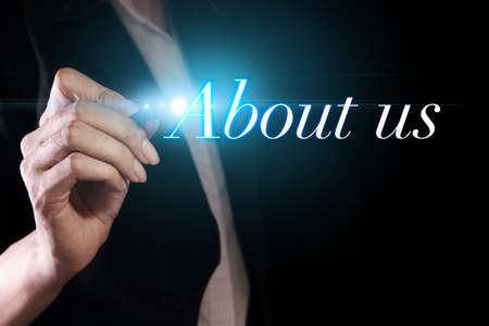 about us: Hand writing about us on virtual screen Stock Photo