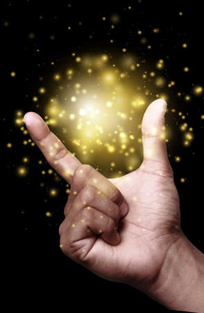 gold colour: Hand showing gold color magic stars light