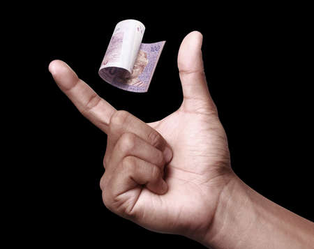 devaluation: Malaysian Ringgit with hand to imply the fall or devaluation of Malaysian ringgit currencies. Stock Photo