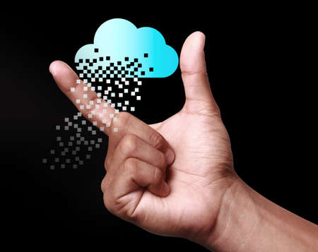 hosted: Cloud computing technology with hand on dark background. Cloud computing is a general term for the delivery of hosted services over the Internet.