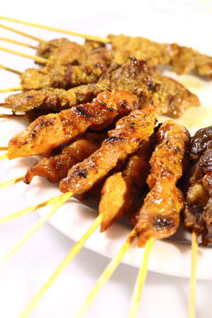 Satay is a Malaysian-style kebab. It is served with a peanut sauce, and slivers of cucumbers and onions.