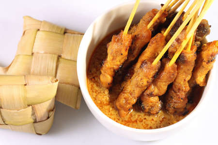 satay sauce: Satay is a Malaysian-style kebab. It is served with a peanut sauce, and slivers of cucumbers and onions.
