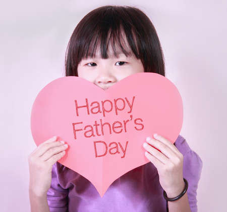 sunday paper: Heart shape paper with a cute little girl. Fathers Day is held on the third Sunday of June in the United Kingdom.