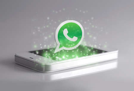 Johor, Malaysia - Jan 1, 2016: Smartphone with 3d Whatsapp icon. Whatsapp is famous instant messaging application for smartphones, Jan 1, 2016 in Johor, Malaysia.