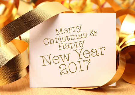 new years day: Merry Christmas & Happy New year greetings with gold decorations. New Years Day, also called simply New Years or New Year, is observed on January 1.