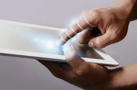 twining: Optical fiber twining around the hand, the hand holding tablet. Stock Photo
