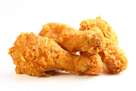 hot and crispy fried chicken legs isolated on a white background Stock Photo
